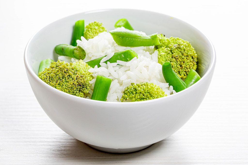 Rice with asparagus and broccoli in a bowl
