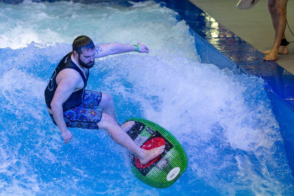 Riding the wave on the Citywave surf machine at fair Boot Düsseldorf 2018