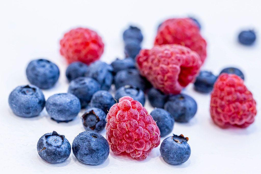 Ripe summer berries of blueberries and raspberries