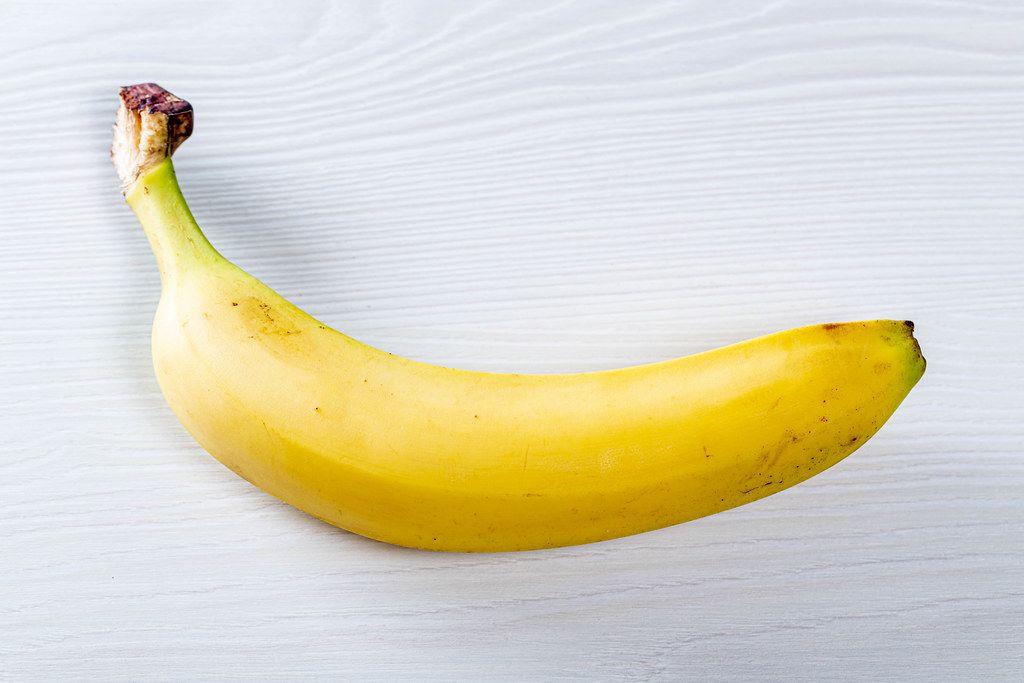 Ripe yellow banana on white background