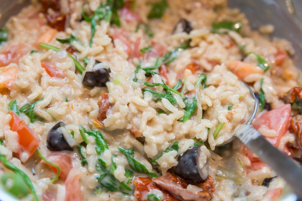 Risotto with dried tomatoes, olives, walnuts and Italian hard cheese