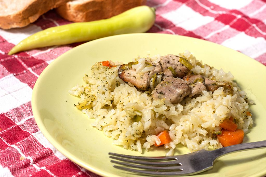 Risotto with Pork Meat meal served on the table