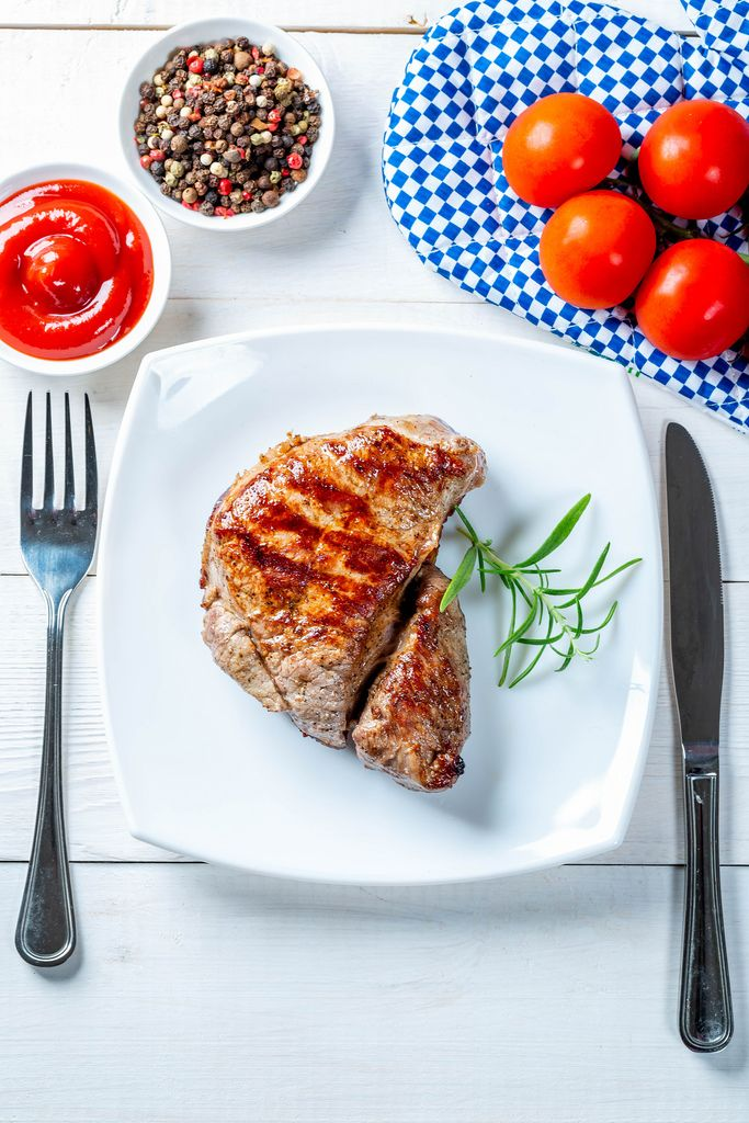 Roasted fresh steak with fork and knife