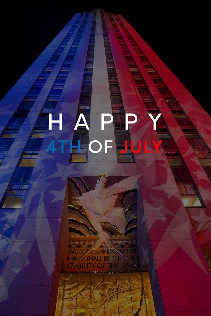 Rockefeller Center in Manhattan, New York, during Election Night, shines in the color of the US flag, with the title Happy 4th of July