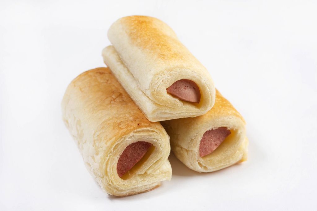 Roll buns with Hot Dog isolated above white background