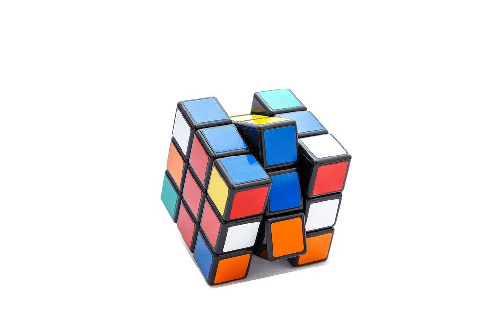 Rotated Rubik's cube 3x3x3 on white background with red and blue lines (Flip 2019)