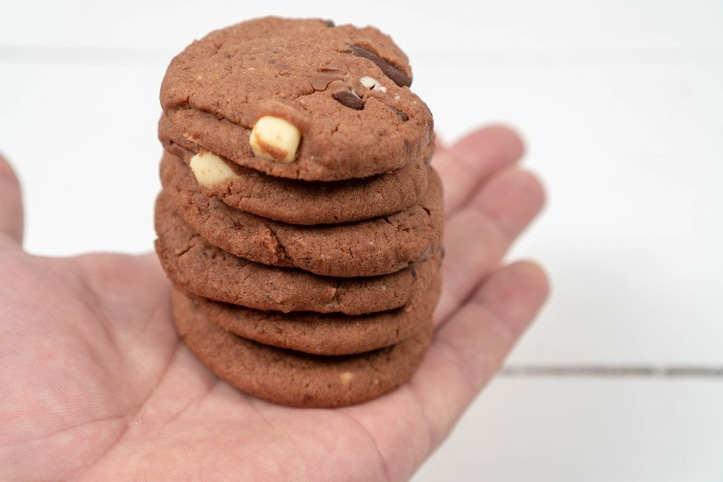 Round Chocolate Cookies on the hand above the table