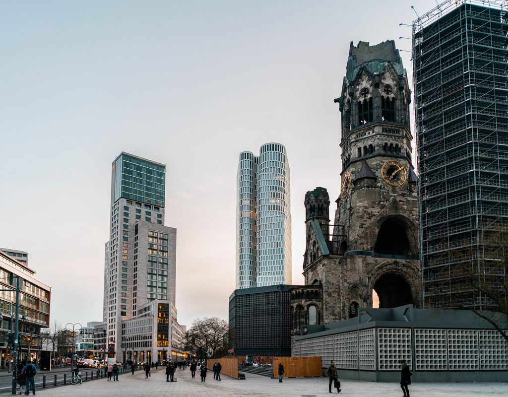 Ruined church of Kaiser Wilhelm next to high-rise buildings in downtown Berlin (Flip 2019)