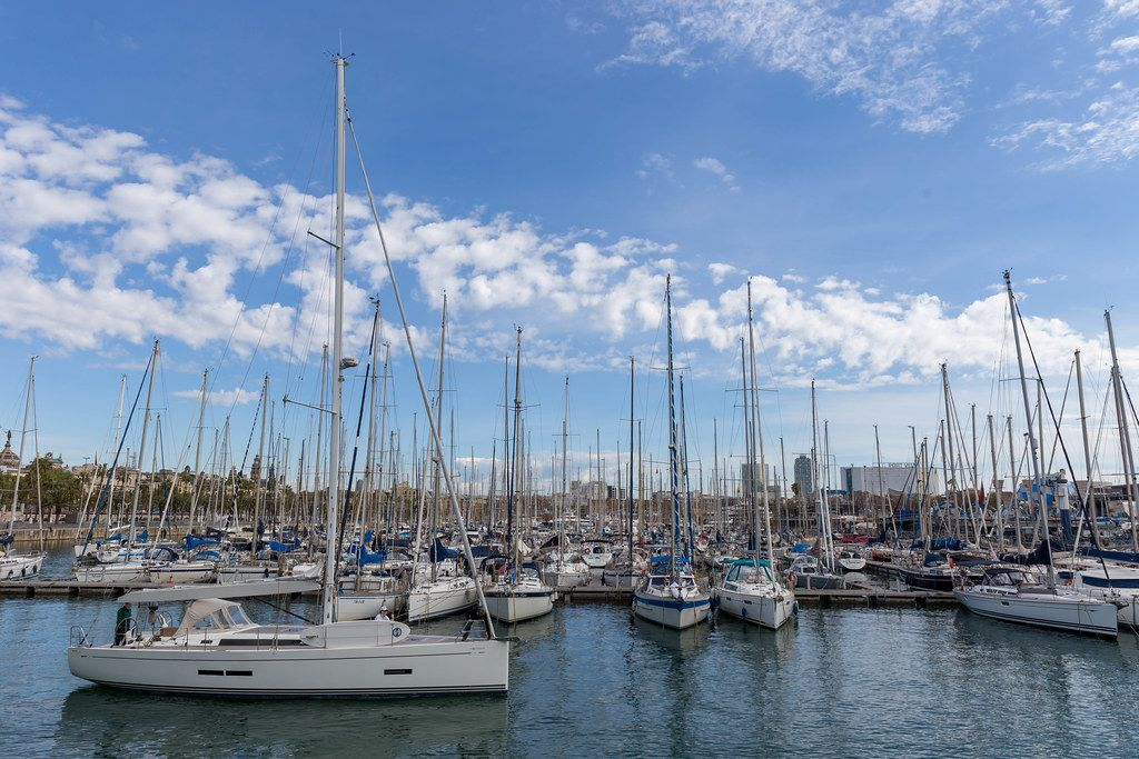 Sailboats at harbour Port Vell, next to promenade Rambla de Mar in Catalonia, Barcelona (Spain)