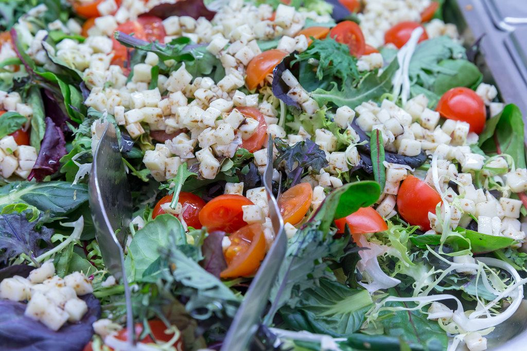 Salad with rocket, cherry tomatoes, spinach and small cheese cubes