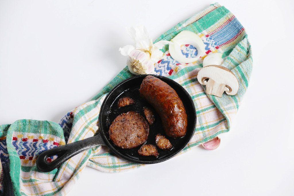 Sausages and salami in a pan