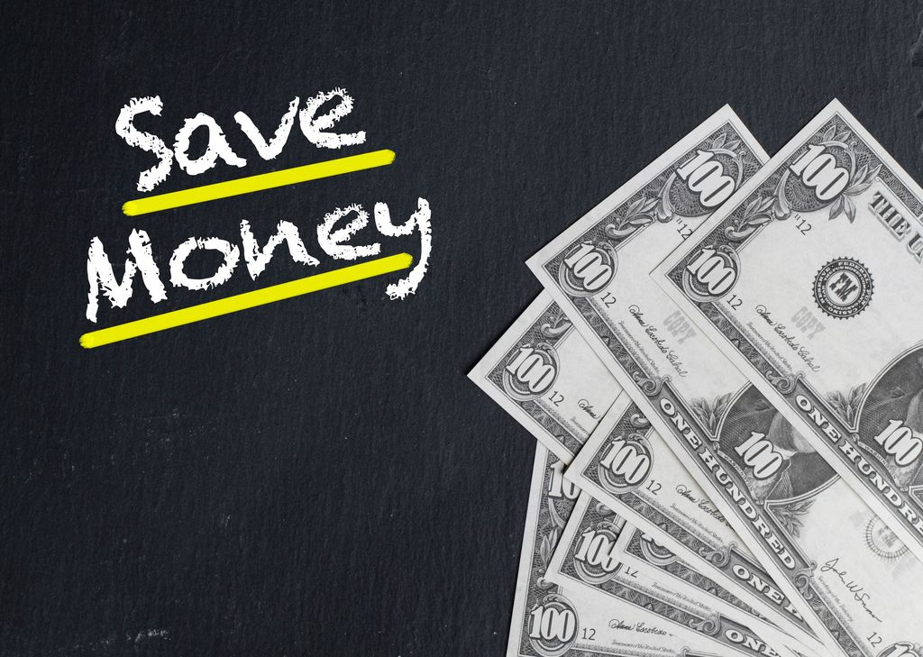 Save Money text with US dollar banknotes