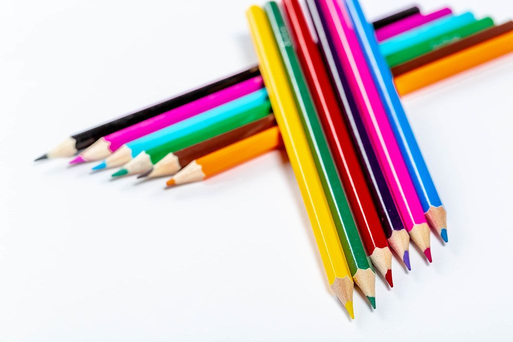 School background with colorful pencils on white background