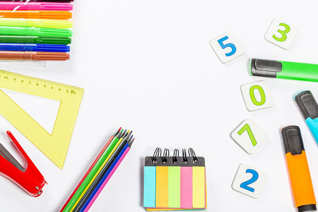 School supplies frame on white background with free space in the middle