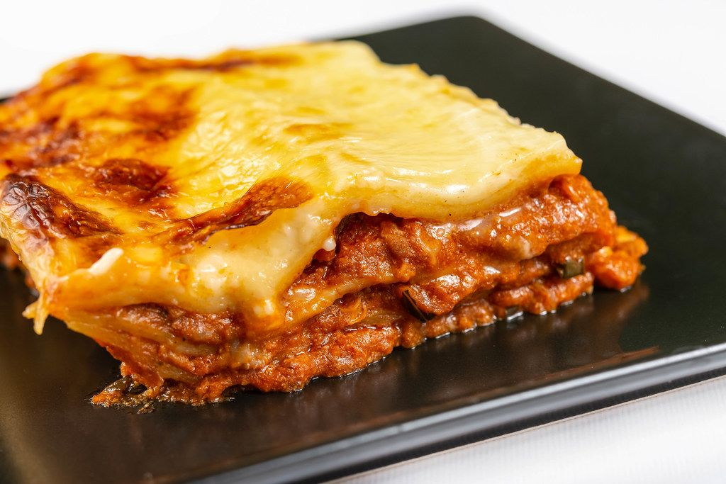 Served Lasagna on the black square plate (Flip 2019)