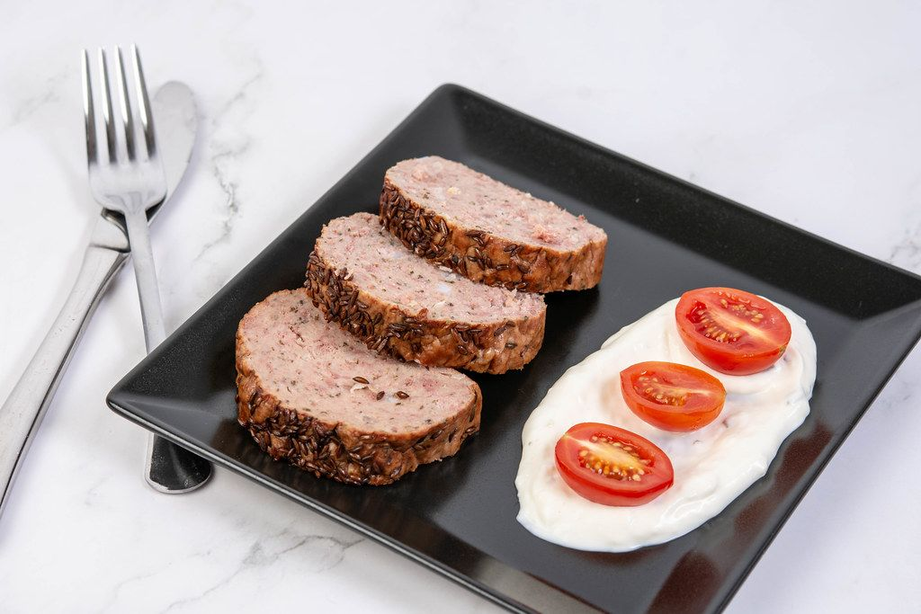 Served Pork and Chicken Meat Loaf with Tomatoes