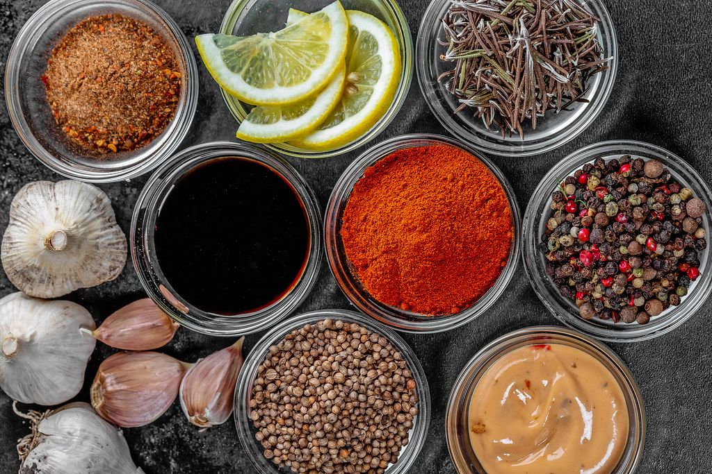 Set of different spices and sauces on a dark background (Flip 2019)