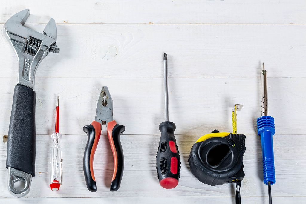 Set of different tools for repair and construction: pliers, screwdriver, tape measure, wrench