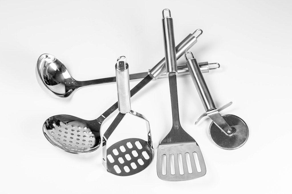 Set of metal kitchen utensils on white background