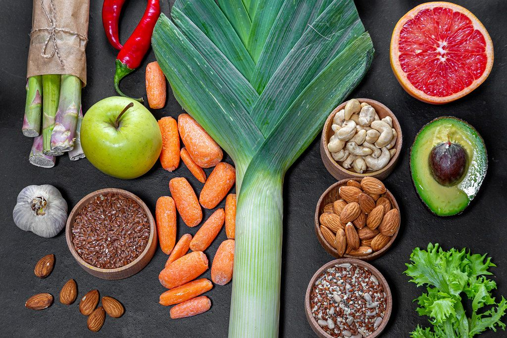 Set of products for healthy food on black background. Top view (Flip 2019)