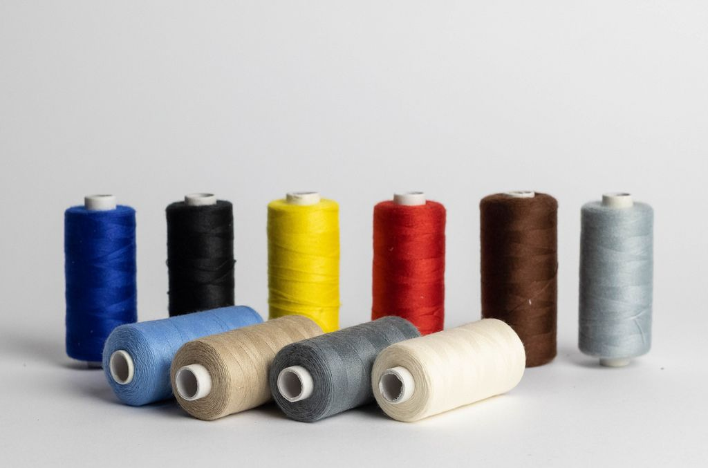 Sewing thread of different colors isolated on white