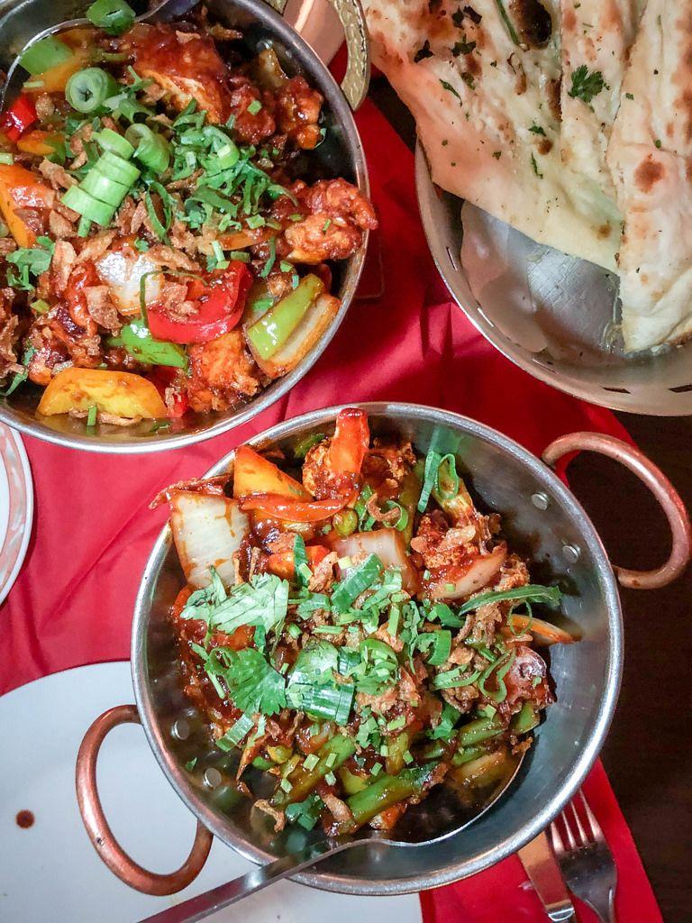 Shabji Garlic Chili - scharfes Gemüse Gericht mit frischem Knoblauch und Chilischoten in einem indischen Restaurant - Ginti in Köln