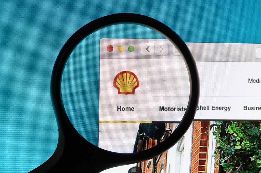 Shell logo under magnifying glass