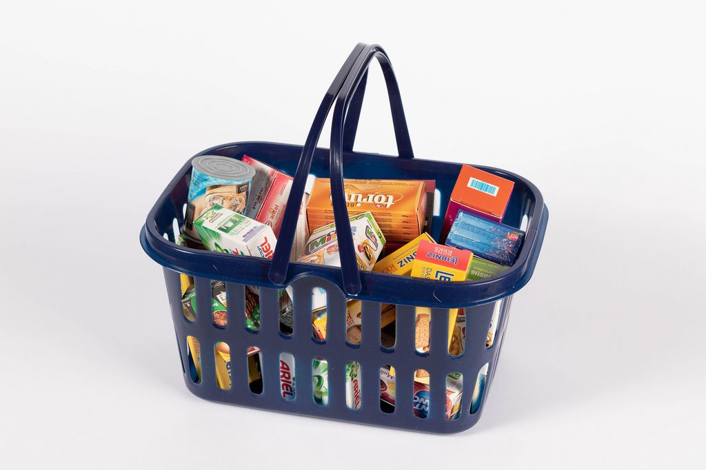 Shopping hand basket full with products isolated on white