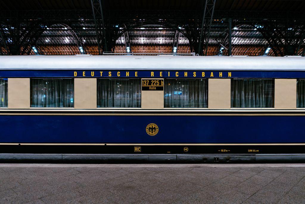 Sideview of antique Reichsbahn blue passenger car (carriage)