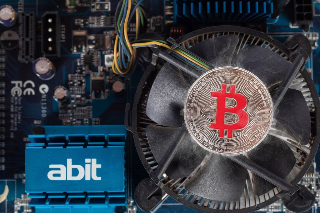 Silver Bitcoin on a computer cooling fan