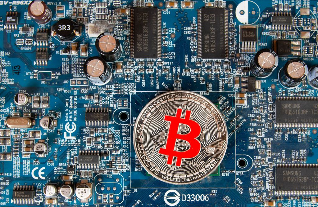 SIlver Bitcoin on a computer mother board