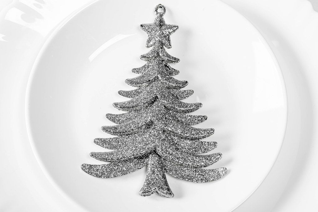 Silvery Christmas tree decor on white plate (Flip 2019)
