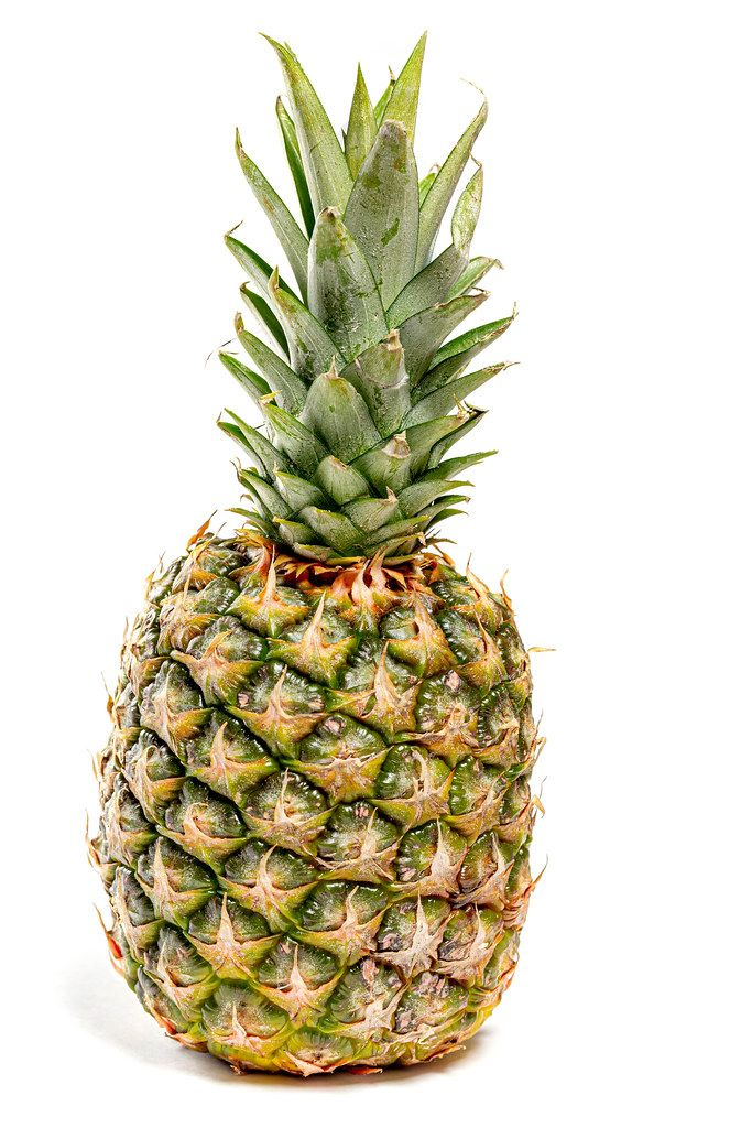 Single whole pineapple on white background