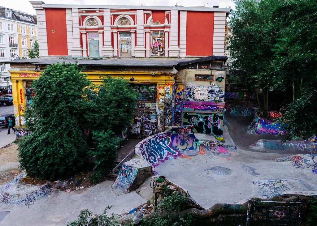 Skateboard court covered in street art