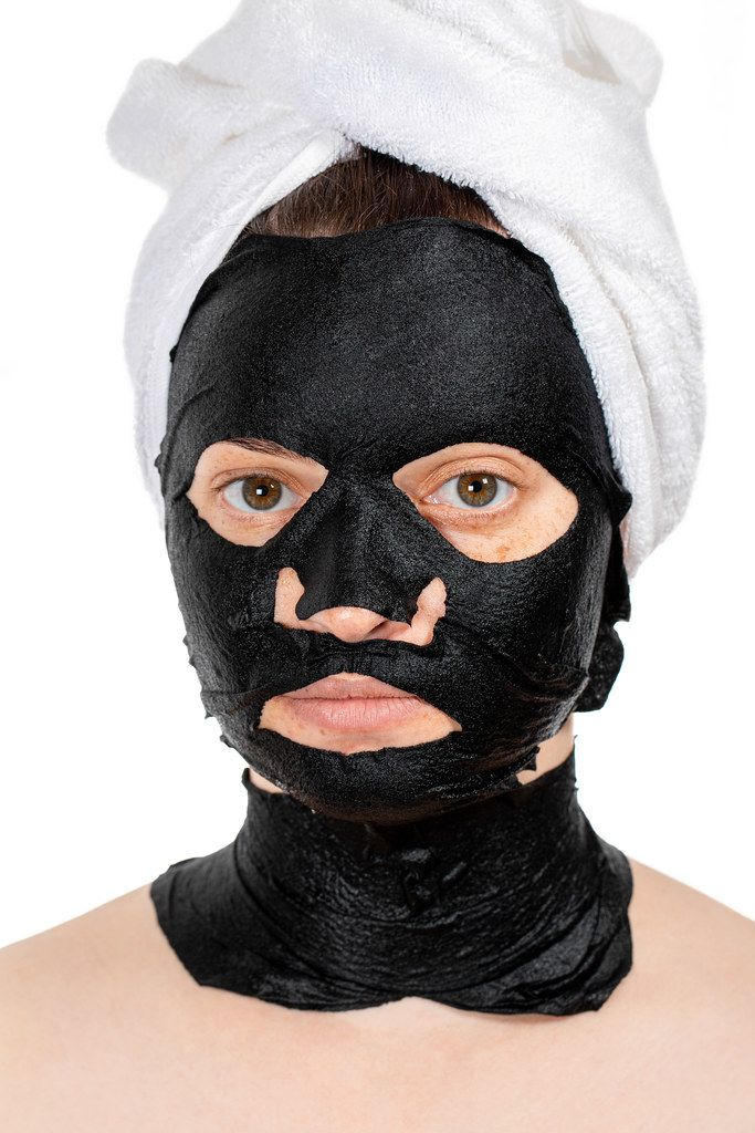 Skin care face concept- black mask on face women