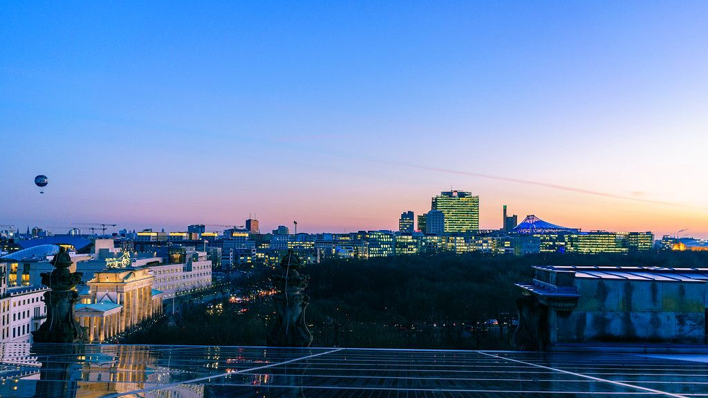 Skyline View of Berlin City at Sunset Blue Hour with Hot Air Balloon