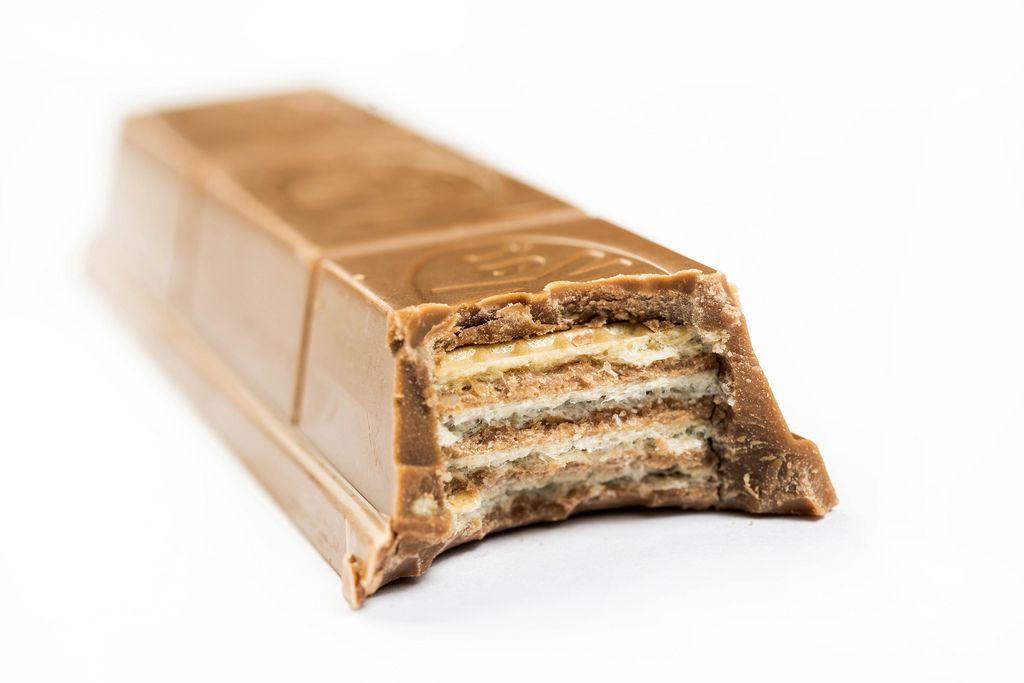 Slice of Kit Kat Chocolate Bar on the white background (Flip 2019)