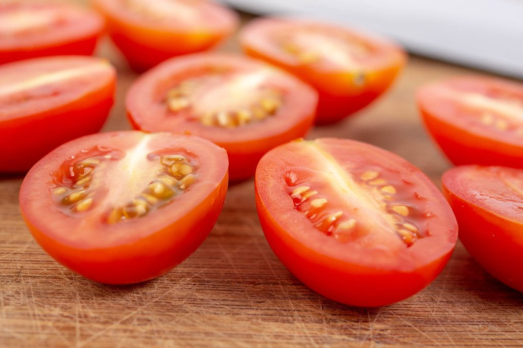 Sliced Cherry Tomatoes on the wooden board