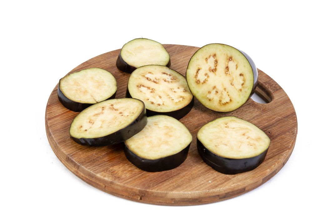 Sliced Eggplant on the roung wooden board