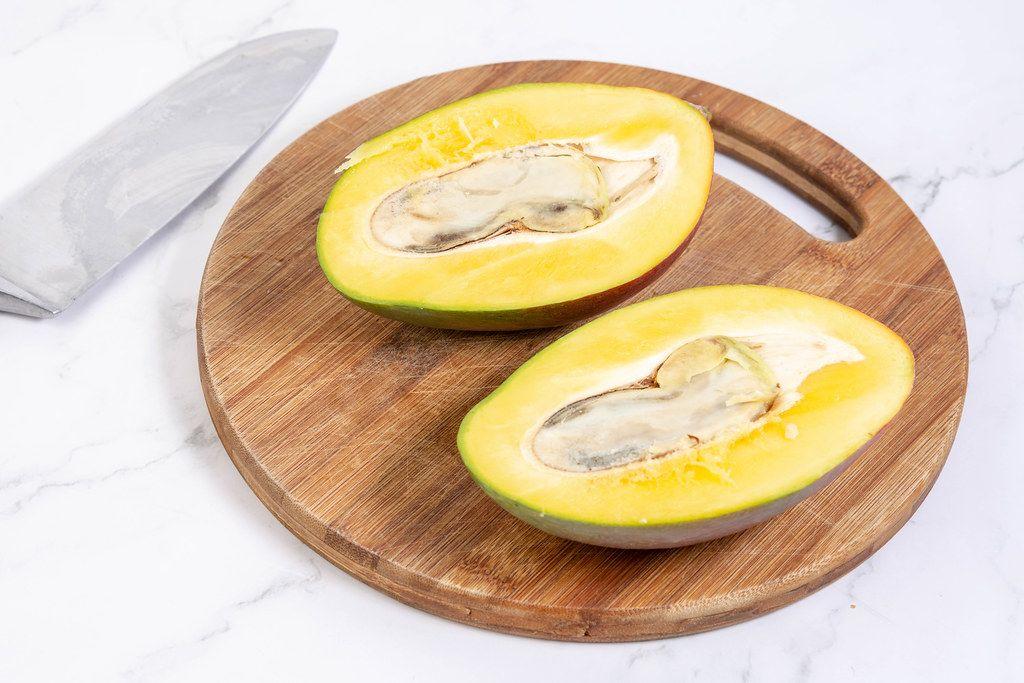 Sliced Fresh healthy Mango fruit on the wooden board