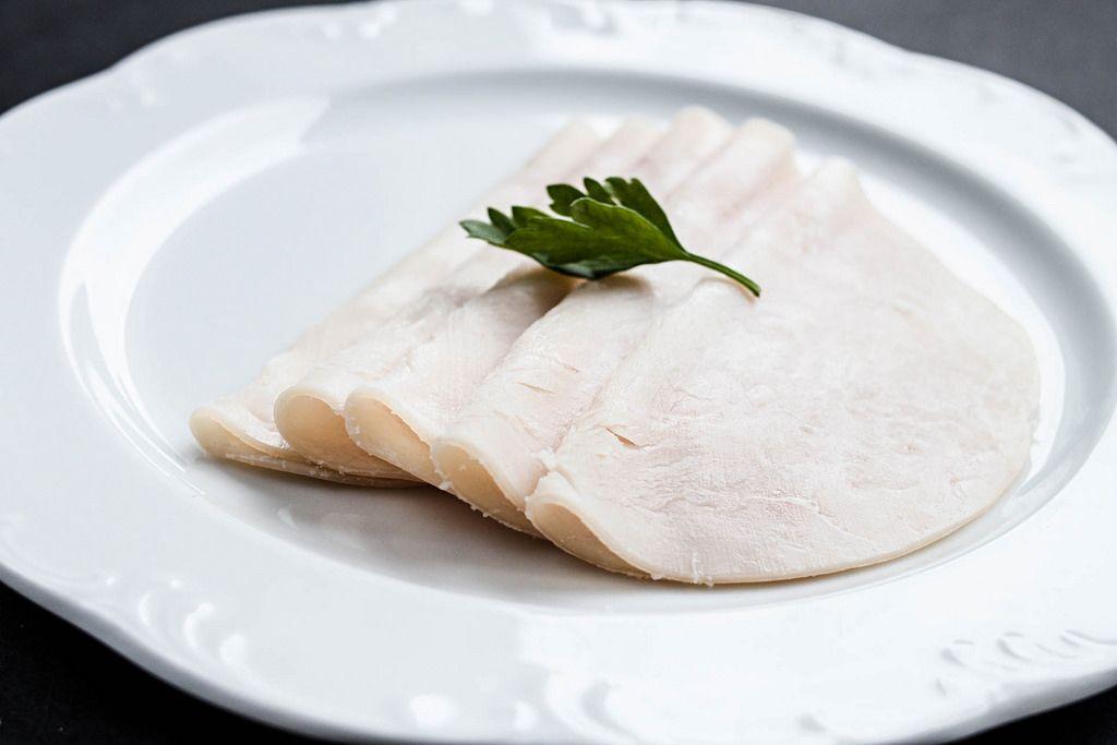 Sliced ham with fresh green lettuce leave
