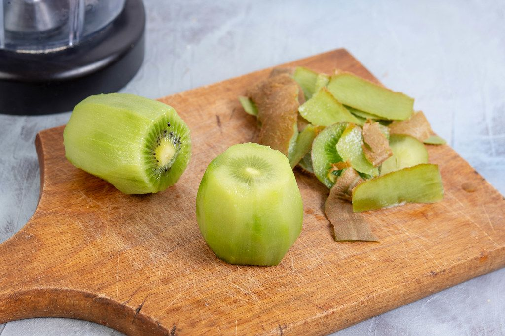 Sliced Kiwi fruit prepared for juice mixer