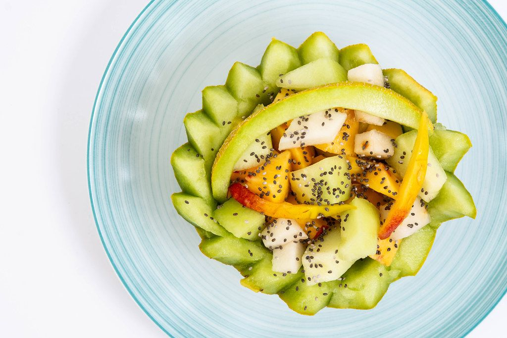 Sliced Melon and Peach with Chia seeds on the plate
