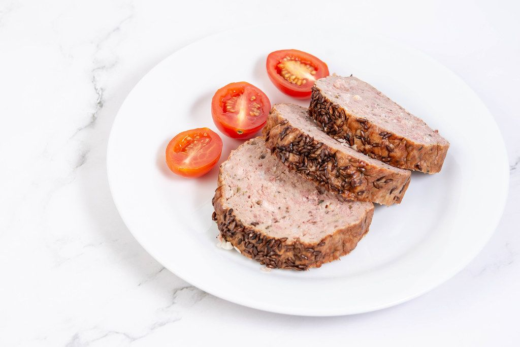 Sliced Pork and Chicken Meat Loaf with Cumin and Tomatoes