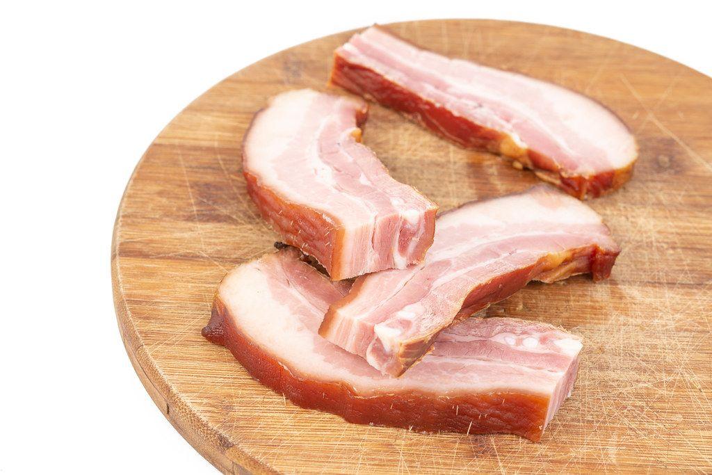 Sliced-Raw-homemade-Pork-Bacon-on-the-cutting-wooden-board.jpg
