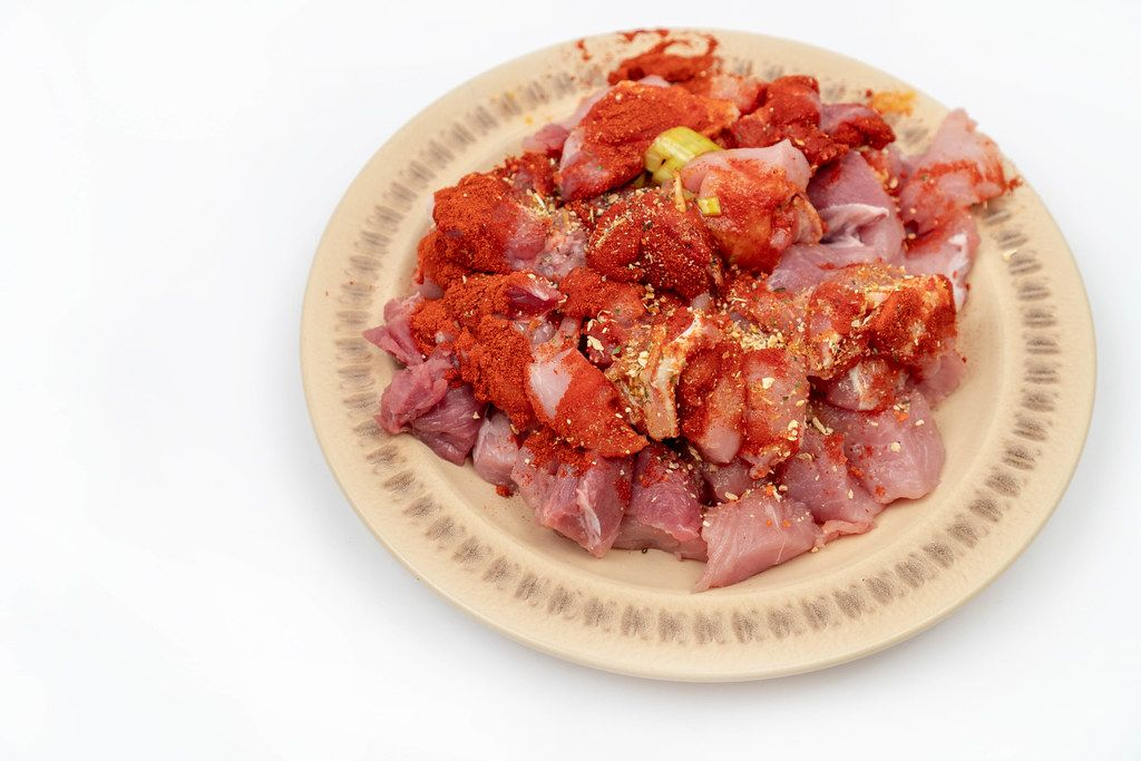 Sliced-raw-Meat-with-Paprika-Spices-ready-for-frying.jpg