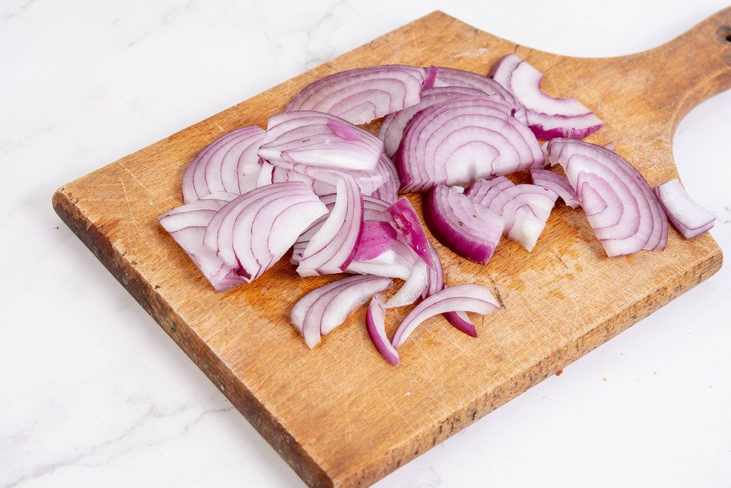 Sliced Red Onions on the wooden board