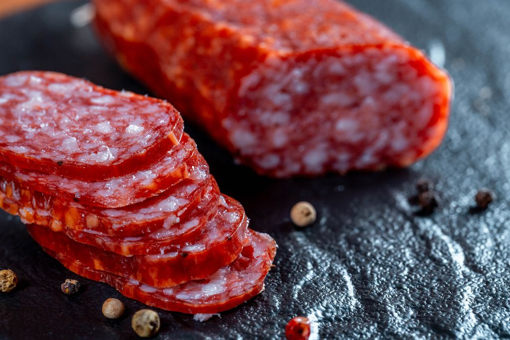 Sliced sausages on black (Flip 2019) (Flip 2019) Flip 2019
