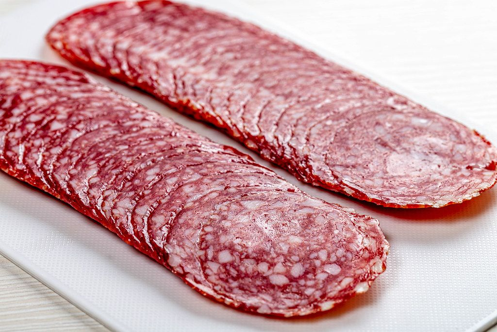 Sliced smoked sausage, close up (Flip 2019)