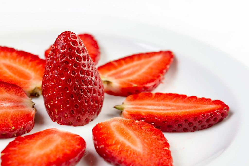 Sliced Strawberries arranged on the plate